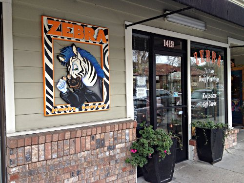 Judging tattoo body piercing parlors zebra beyond for Tattoo shops in lafayette